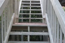 Stairs to balcony and private entrance to upper unit