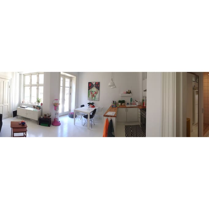The living room and kitchen, a lovely way to cook and have company in the same time ☺️  - and the French balcony.