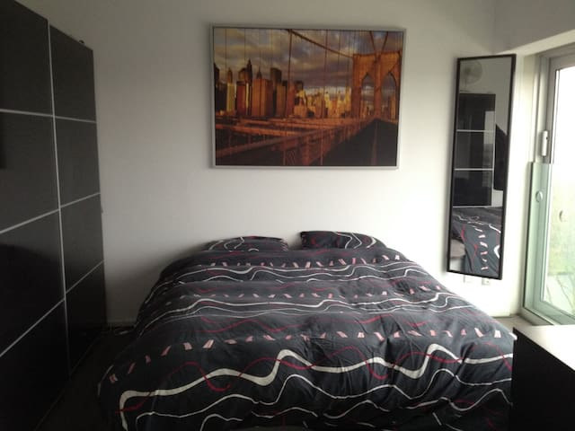 Master bedroom with an fantastic view of Amsterdam, a king size comfortable bed and a big wardrobe to put your clothes in.