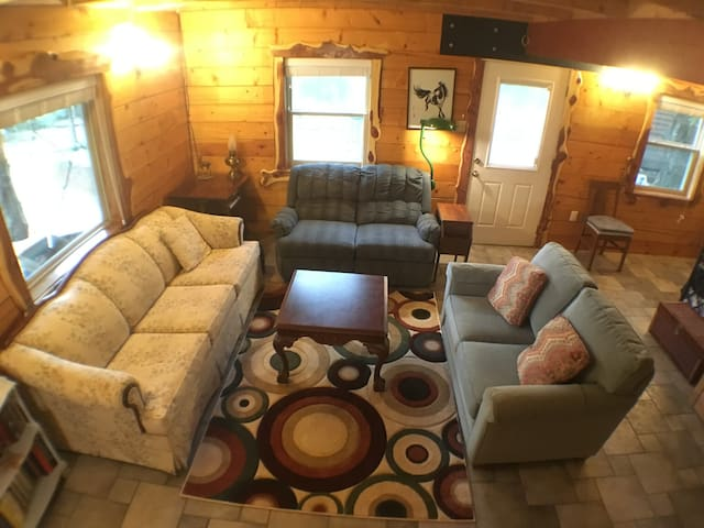 Living room. We can actually seat fifteen, for day trips, but charge the one night fee.