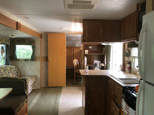 Kitchen living room looking into bunk room.