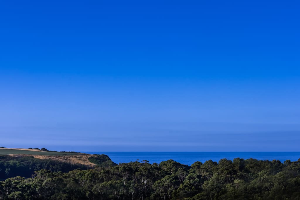Enjoy the huge back deck with sensational views out to the sea and hills