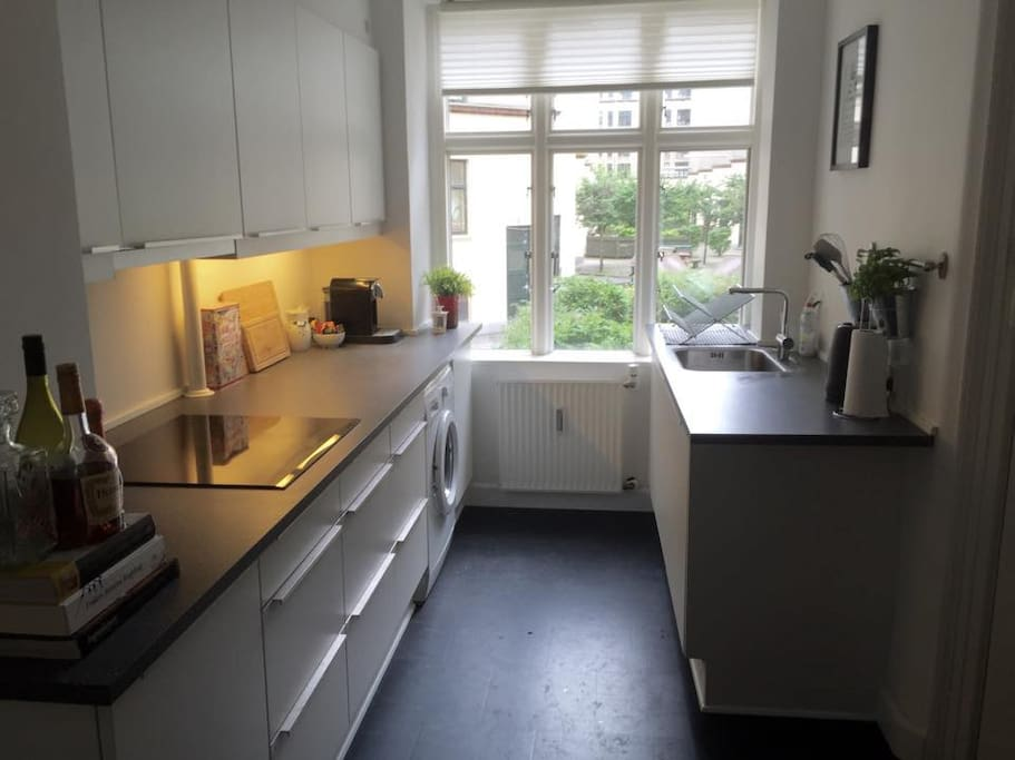 Kitchen with dishwasher, washing machine, coffee machine and cooking facilities free for use.
