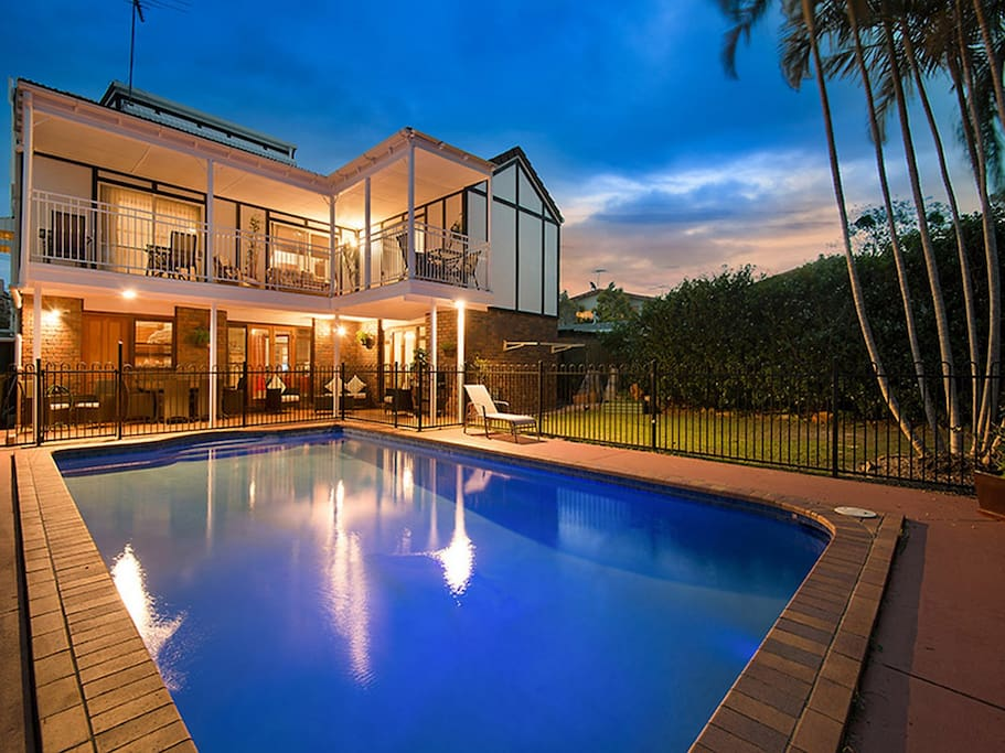 Large in ground swimming pool for the use of guests. This room opens onto the deck overlooking the pool.