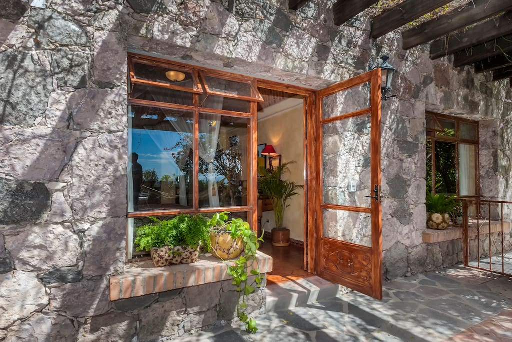 Charming master suite with private entrance features a king bed with gorgeous views, adjacent terrace, writing desk, refri, microwave and more!