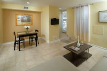 Enter this unit to find an adorable living room and dining room area.