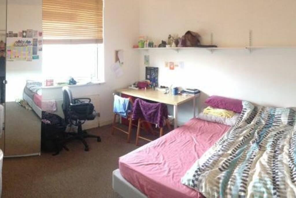 The room (taken with a panorama app so it looks a bit smaller than what it is)