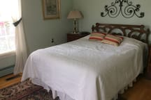 Queen bed with private bathroom on first floor and view of Seneca Lake.