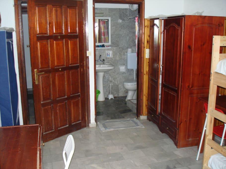 View of entrance, bathroom, wardrobes