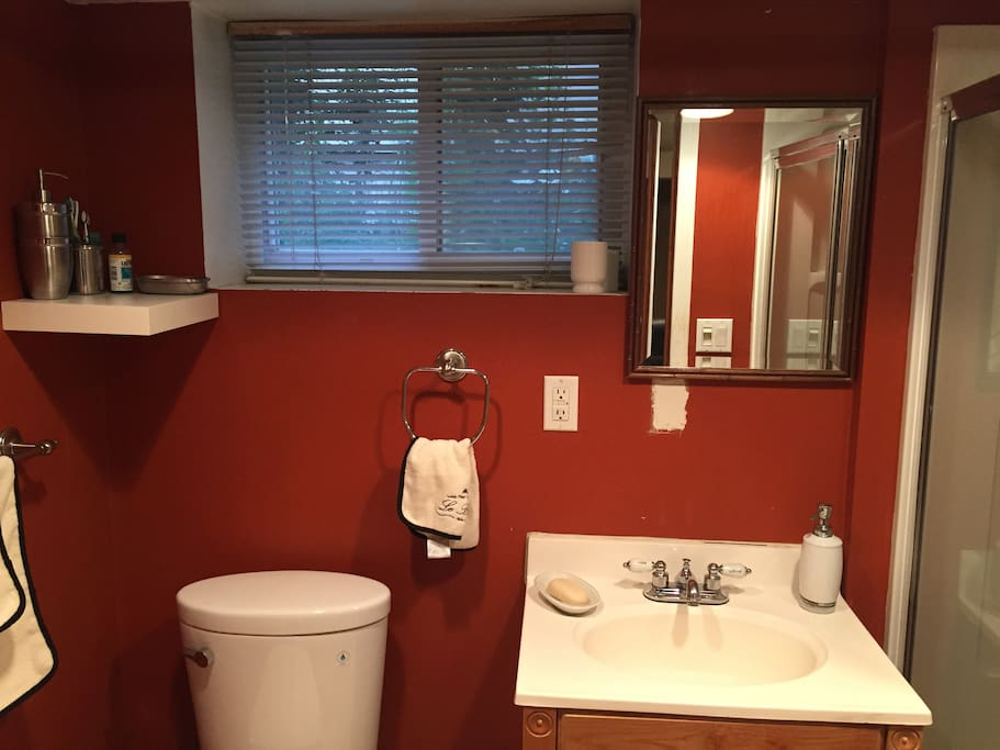 Good size bathroom with space for all your toiletries! We include fresh hand and body towels.