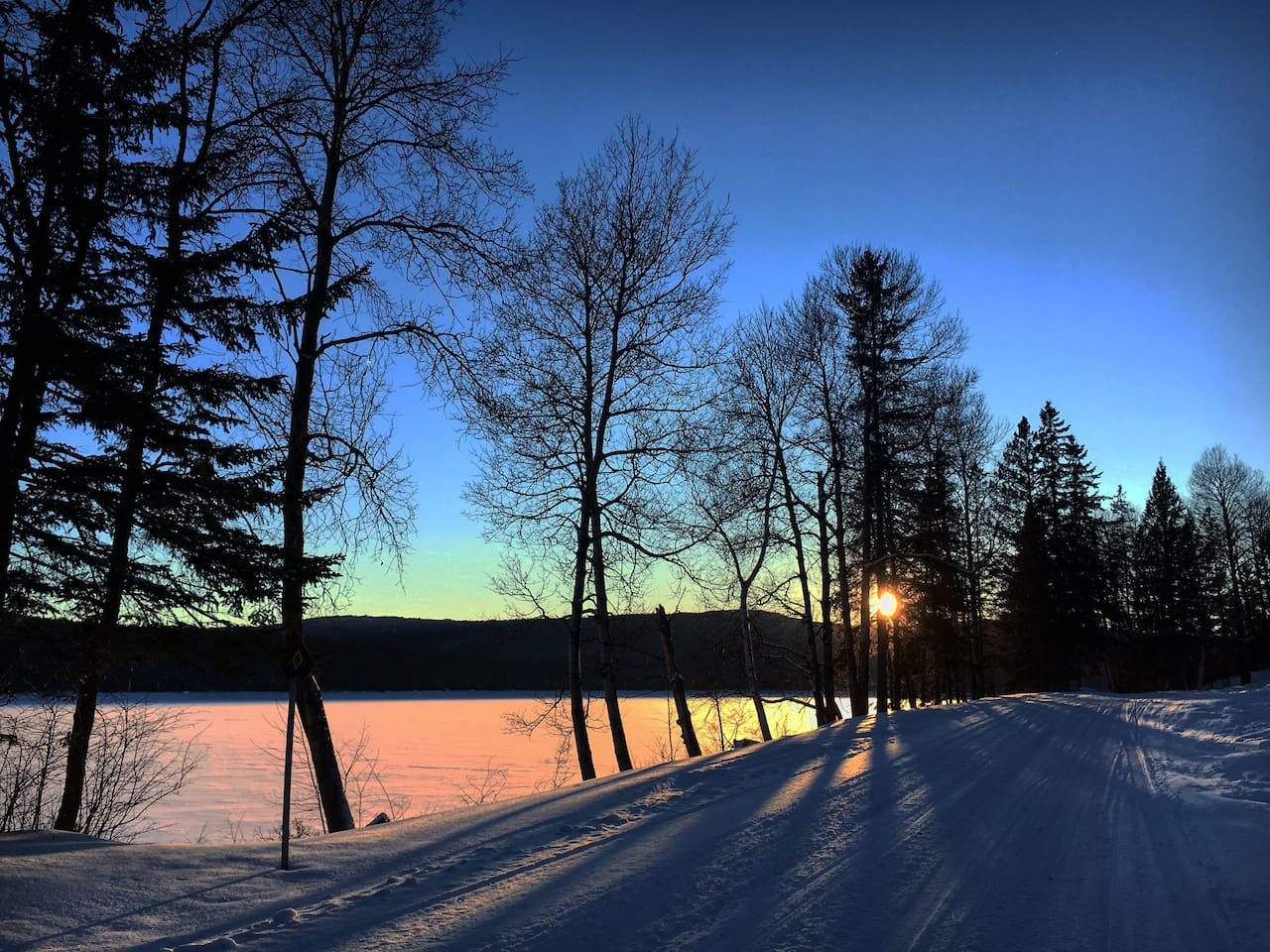 Photo of snowmobile trail at sunset by Lake Francis in Pittsburg, NH (not the view from Kelly's Cottage)