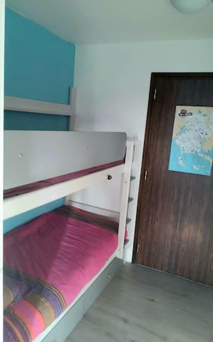 Entrée cabine avec les lits superposés