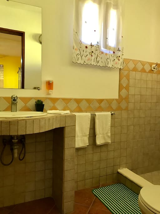 VILLA 2 -  Full bathroom with sink and mirror..