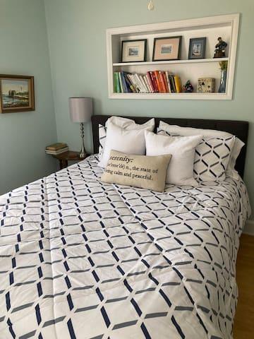 Bedroom #1: Queen Bed to the left of the bathroom.