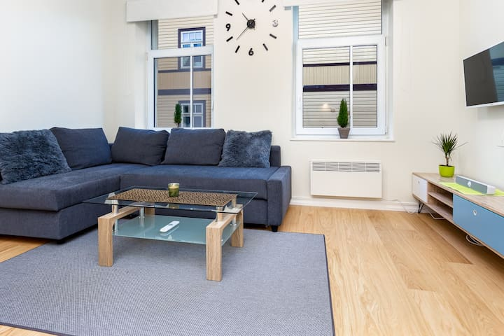 Modern centrally located apt. with a fire place