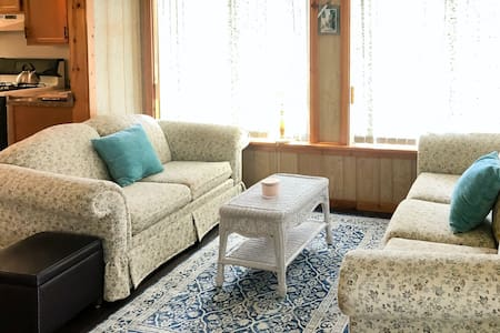 Pleasant bayside home w/ water views, private dock, firepit, and enclosed porch!