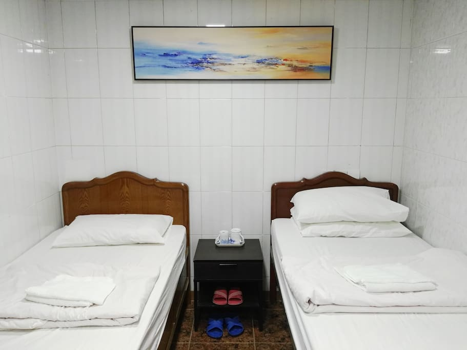 Two single beds in one side