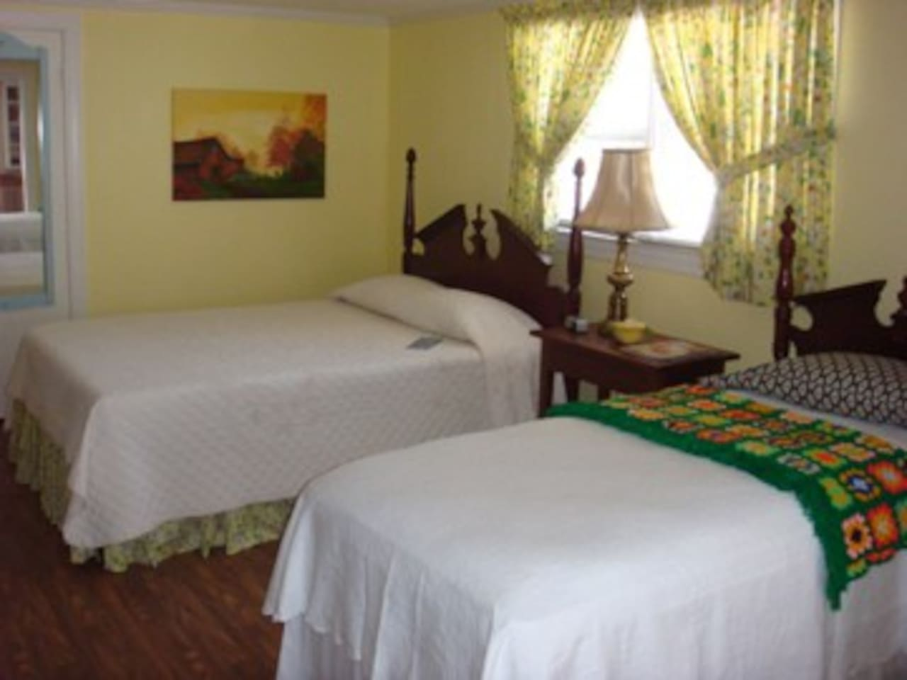 Shine's Suite is located downstairs features a queen, and twin bed. Shine's Suite also has a private bathroom, sunroom and a deck with access to the patio area!