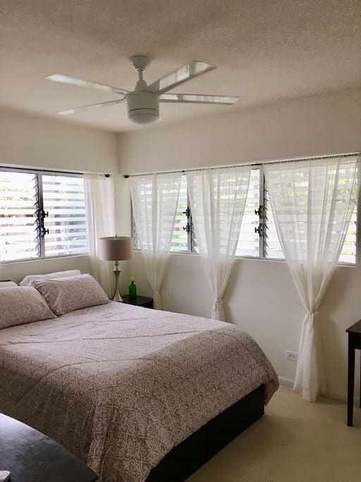Airy bedroom surrounding by trees