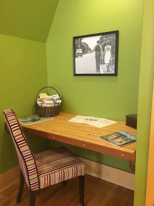 Desk made out of old bowling alley lanes. Basket of local attractions to fill your days!