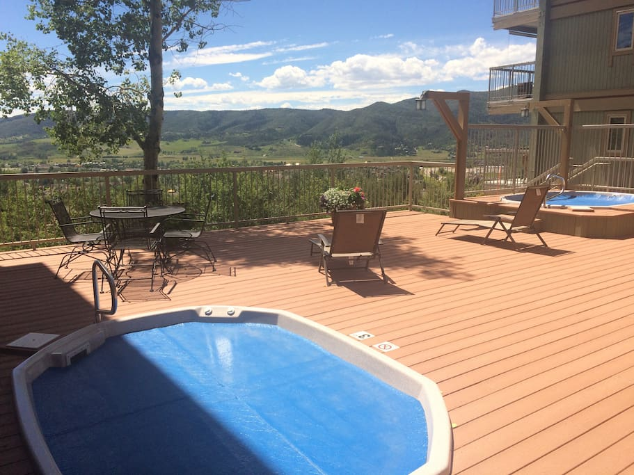 Enjoy 2 large hot tubs with a view!