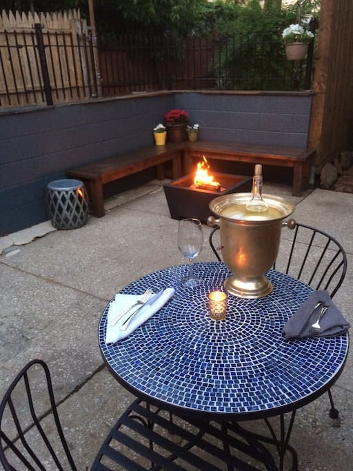 Our back patio is a quaint, quiet sanctuary with plenty of seating and a gas BBQ