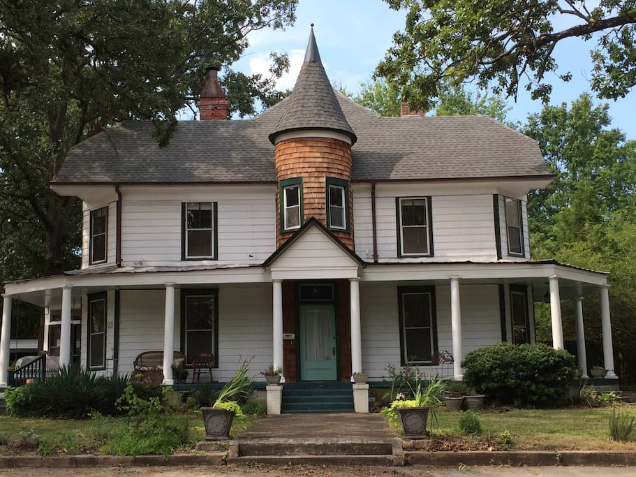 1910 Victorian in the southern summer.  Wrap-around porch and porch swing are yours to use!