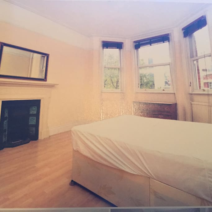second room with 2 single beds