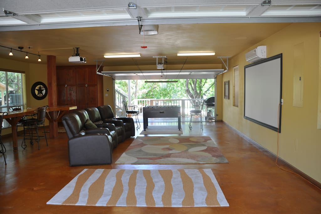 Large media room with Projection Movie Theater System.