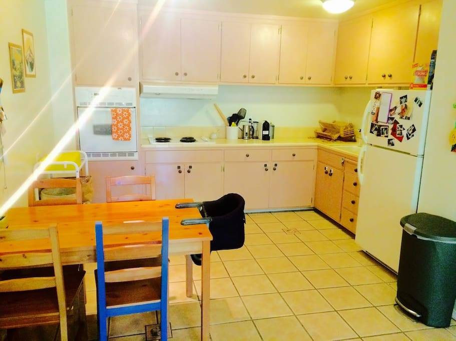 Kitchen: large, pink, fully stacked kitchen. includes microwave, stove, electric grill and fridge.
