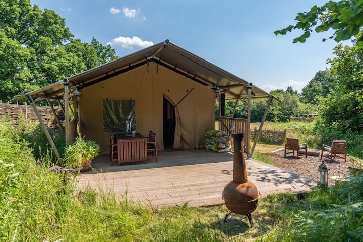 Luxury en-suite safari tent with log burning stove