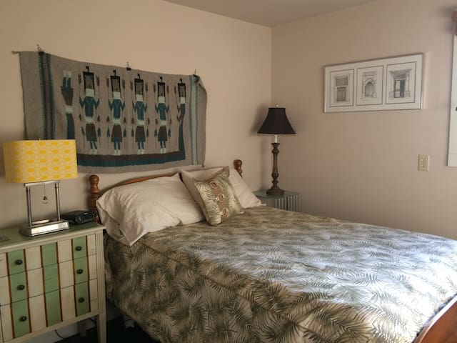 Bedroom with comfy bed and art.