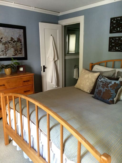 Bedroom with comfy Queen bed, closet, and attached to full bath. Extra towels and amenities provided.