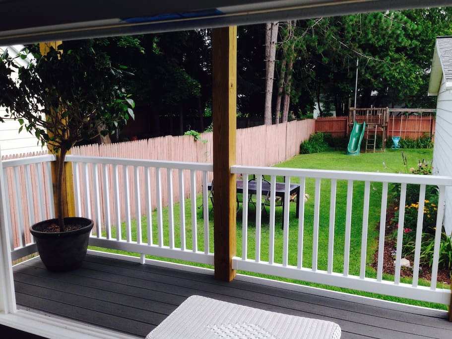 View from kitchen into back porch/spacious back yard.