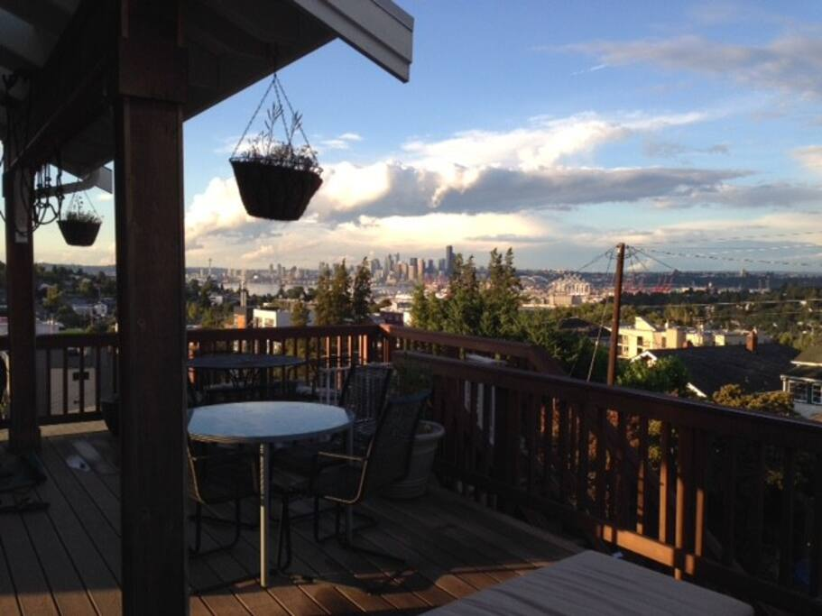 Gas BBQ and table on the deck with views of the city.