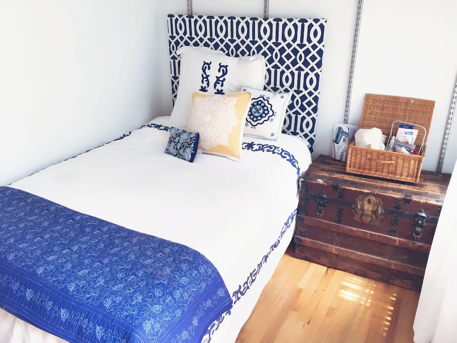 Bed with down comforter, clean towels and accessories for your stay