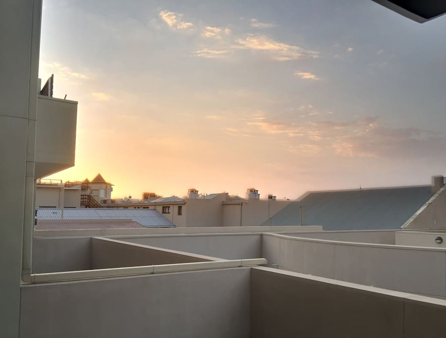 The view from the patio over the rooftops in the late afternoon