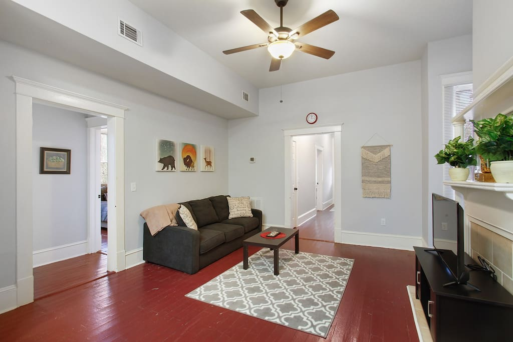 The 2nd-story unit boasts vaulted ceilings, hardwood floors, and 3 decorative (non-operational) fireplaces.