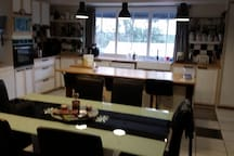 Large kitchen with lots of space. Breakfast bar and large dining table.