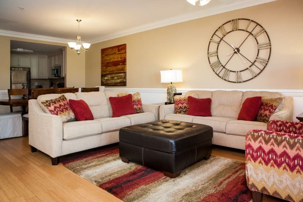 Two comfy sofas plus chairs offer plenty of seating in the large living room