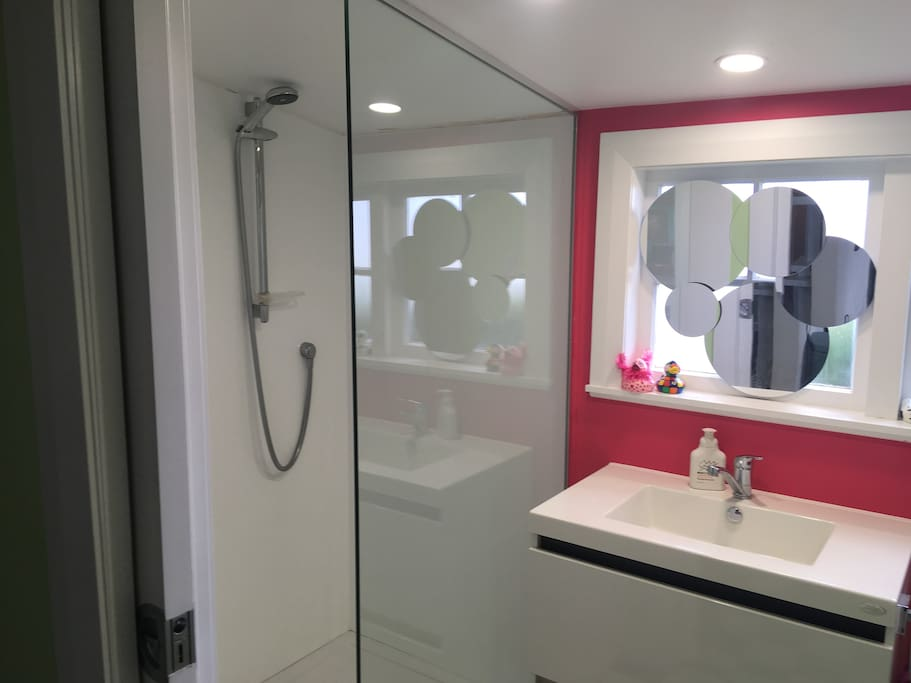 recently refurbished bathroom with shower and laundry
