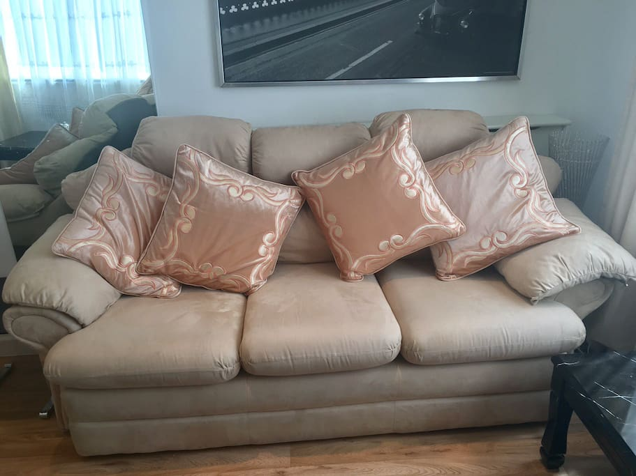 Comfortable three seater sofa, cosy for a sleep over