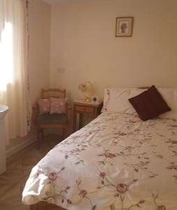 A comfortable room with a double bed & Own shower