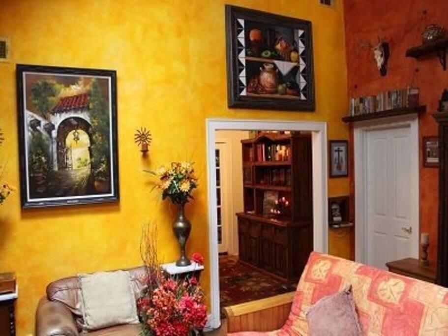 Living room has vaulted ceilings