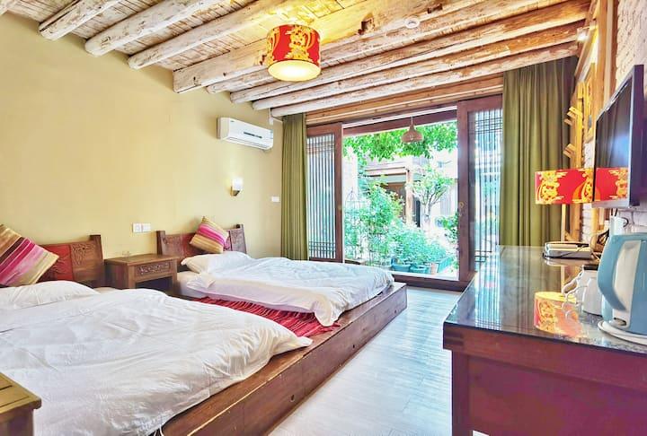 丽江古城内豪华精致标间。带空调。wifi。独立卫生间,公用厨房。