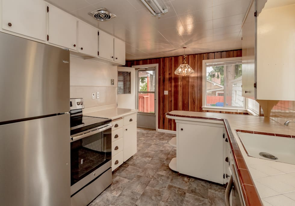 Fully furnished kitchen with stainless full size refrigerator and ice-maker, electric oven/range, microwave and dishwasher. 4 person dining room table. And Kurieg Coffee pot.