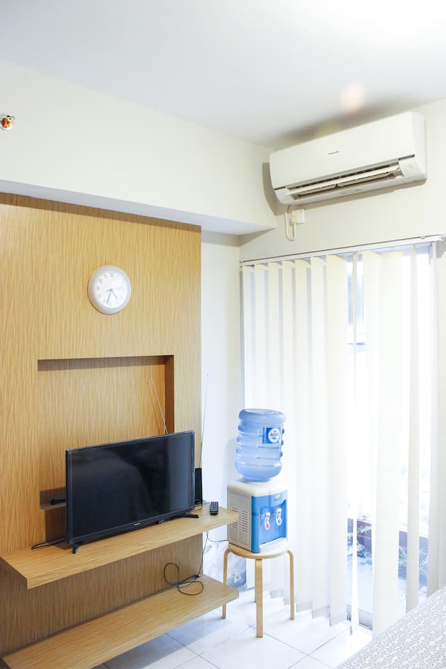 """- Samsung 32"""" Flatscreen TV - Water Dispenser (water will be provided during your stay) - Air conditioner - Balcony with pool view"""