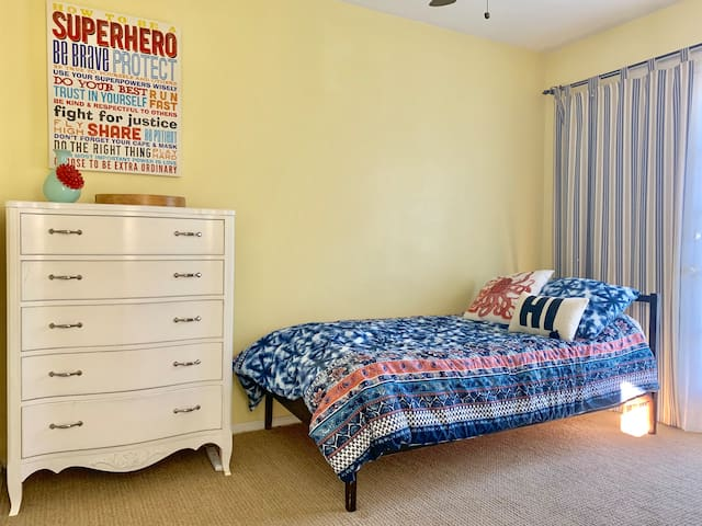 Sunshine throughout the room! Large dresser and closet in room