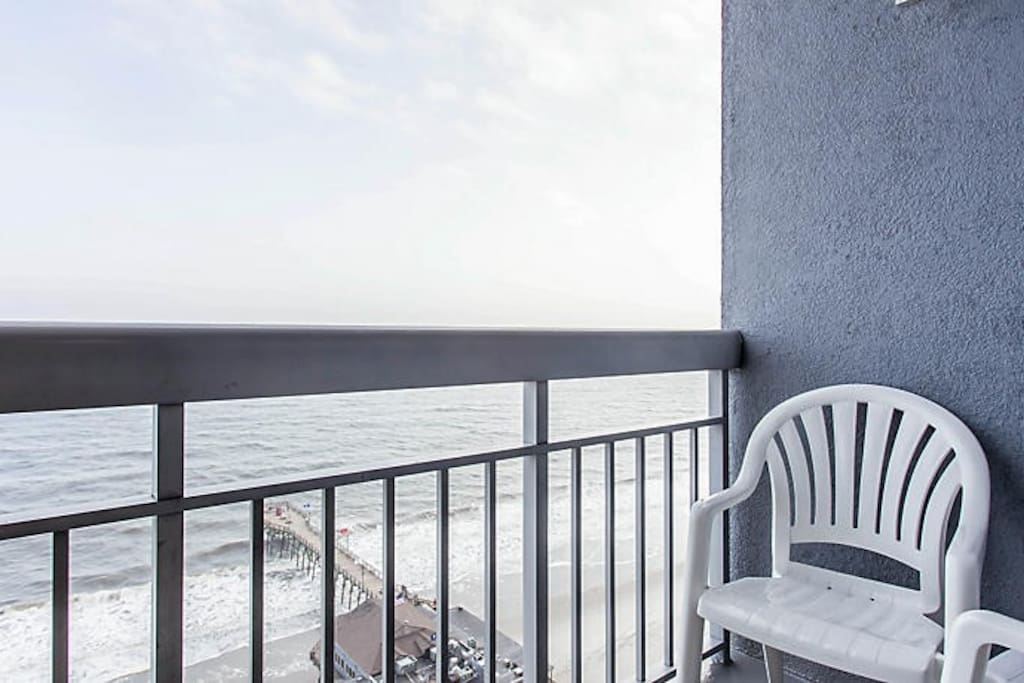 OUTDOOR BALCONY OVERLOOKING THE BEACH