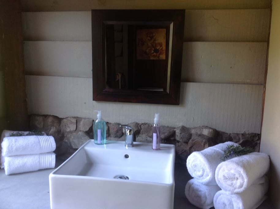 En suite bathroom with shower. Lavender products with lavender from our gardens